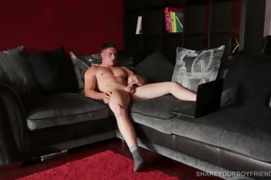 Nasty Dude On A Black Couch Jerking His Boner