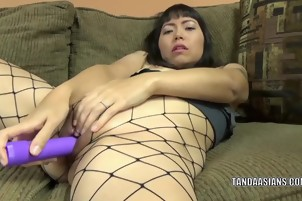 Asian Girl Plays With A Purple Toy While Wearing Fishnets