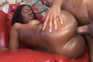 Black Babe Gets Oiled Up And Fucks Couple Of Guys