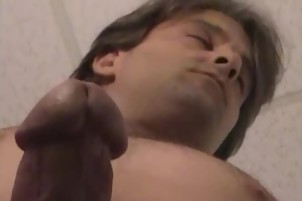 Older Guy With Long Hair Strokes Off His Man Meat