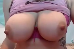 Girl shows her big tits front the webcam
