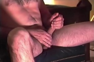 Old Hairy Cowboy Daddy Strokes His Dick On Cam